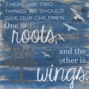 Wooden quote: Two Things we should Give our Children