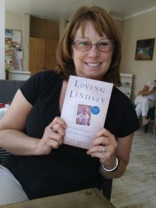 Statesman Journal photo of Linda Atwell holding Loving Lindsey